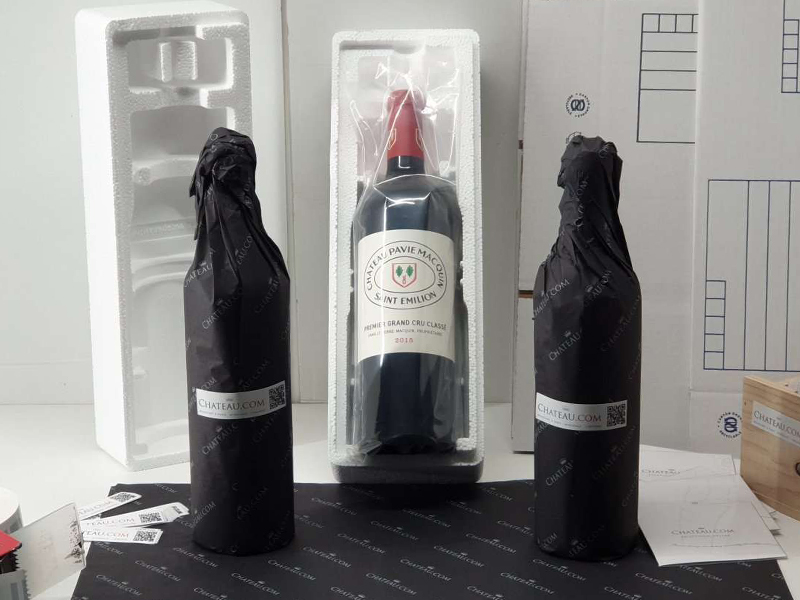 Bottles wrapped in tissue paper or in a protective pouch before being placed in a protective polystyrene